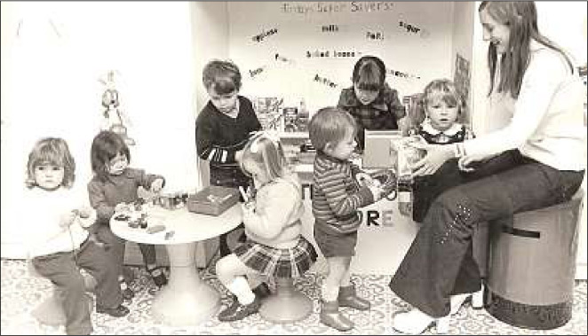 In this black and white photograph from the 70's, Tiny Tots' owner Tina Jones leads playtime.